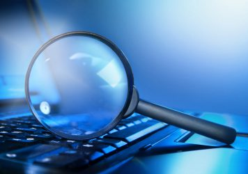 A laptop with a magnifying glass - what to do before you start SEO