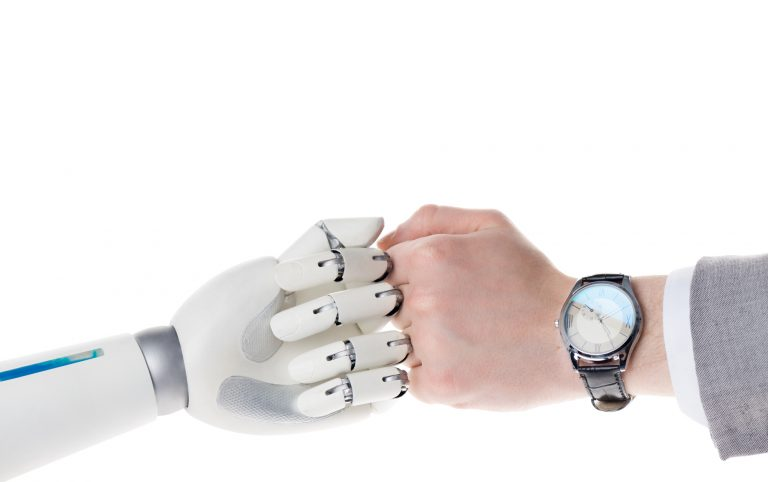 A human and robot fist bumping, representing marketing automation