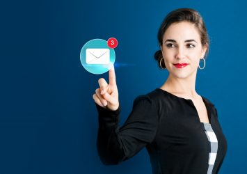 A person tapping an email marketing icon.