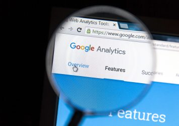 A magnifying glass over Google Analytics - how to add a user to Google Analytics