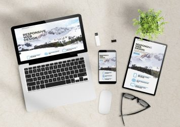A website shown on a laptop, a mobile phone, and a tablet - this covers a website checklist for small business