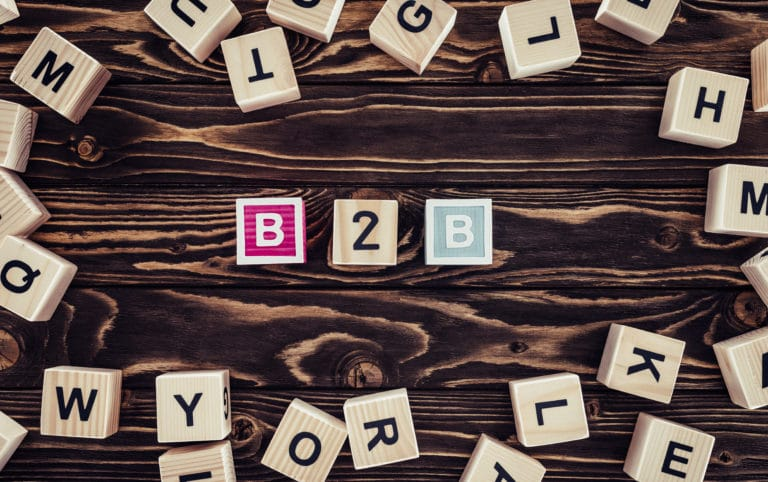 """Board game letters scattered across a table with colorful letters in the center that spell """"B2B"""" - Black Friday Cyber Monday for B2B"""