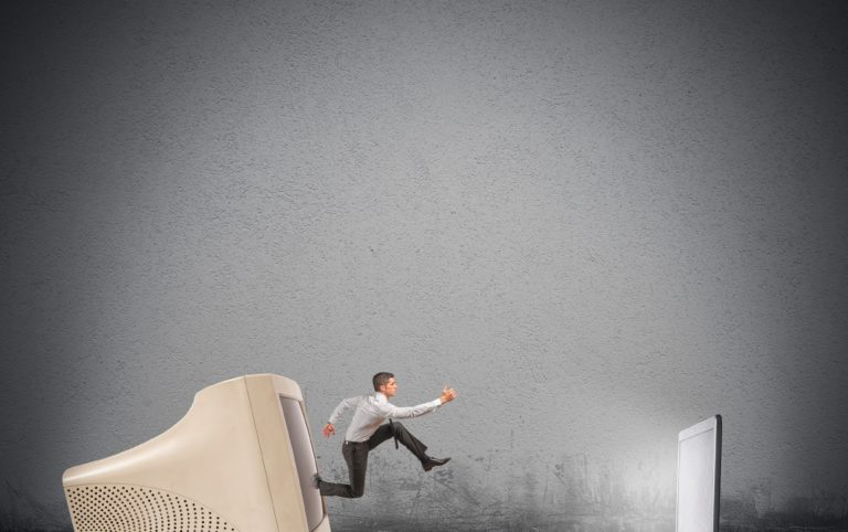 A person jumping out of an old computer into a new laptop, representing upgrading your lead funnel
