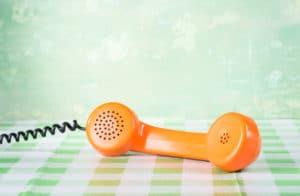 A landline phone lying sideways on a table