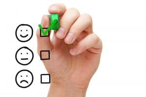 3 checkboxes measuring happiness with a hand marking the top choice
